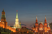 Illuminated ornate buildings, Moscow, Russia