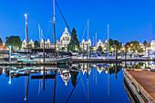 Parliament Buildings and harbor illuminated at dawn, Victoria, British Columbia, Canada