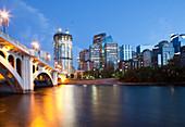 Centre Street Bridge and Calgary Skyline, dusk, a tall building under construction, Calgary, Alberta, Canada