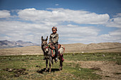 Kirgise on donkey in the Pamir, Afghanistan, Asia