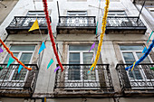 Old building facade with garlands decorated in Lisbon, Portugal