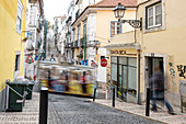 Tourists in the carriage of the Elevador da Bica, Calcada da Bica pequena, Lisbon, Portugal