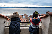 Children look from Lake Meersburg to Lake Constance, Baden Wuerttemberg, Germany