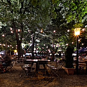 View of the beer garden at Wiener Platz at night, Munich, Bavaria, Germany