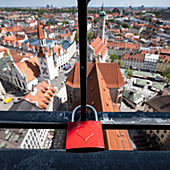 View of the roof of the Peterskirche from the old Peter, in the foreground a love castle, Munich, Bavaria, Germany