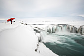 Winter kayaking on Godafoss in northern Iceland