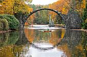Canoeing in autumn on the Rakotzsee, Saxony, Germany