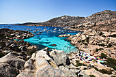 View of the ships and people bathing in the bay of the Isola di Maddalena, Sardinia, Italy, Europe