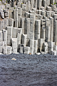 Basalt columns on the beach with parked hiking boots, Vik i Myrdal, South Iceland, Iceland, Europe