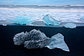 Blocks of ice on the Black Diamond Beach in southeast Iceland, Breidamerkursandur, Iceland, Europe