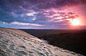 Person watches the sunrise from the Dune de Pilat, Dune de Pilat, Aquitaine, France