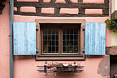Shutters in half-timbered house in Eguisheim in Alsace, France, Europe