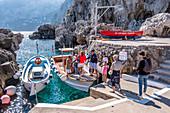 Boat transfer to Marina Piccola from the Fontelina bath on Capri, Capri Island, Gulf of Naples, Italy