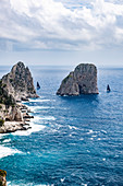 View of the Faraglioni rocks with regatta yachts, Capri Island, Gulf of Naples, Italy
