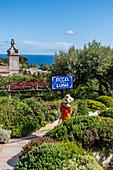 Woman at the entrance to Hotel Luna on Capri, Capri Island, Gulf of Naples, Italy
