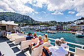 People on the ferry entering Capri, Capri Island, Gulf of Naples, Italy