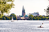 View over the Aussenalster to the town hall, the St. Nikolai memorial and the Elbphilharmonie in Hamburg, northern Germany, Germany