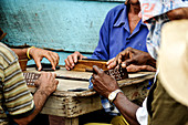 Men play dominoes on the street in the capital of Cuba. Havana.