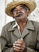 Portrait of an old man with a cigar and straw hat. Vinales. Cuba