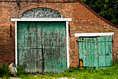 Old wooden gates on a brick building in Krummhörn. Germany. Ostfriesland. North Sea