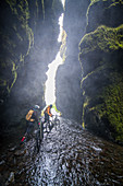 Iceland, road trip, midsummer night, mountain bike, MTB, e-bike, cyclist, cave, waterfall