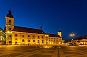 Piata Mare with Roman Catholic parish church and town hall tower at sunset, Sibiu, Transylvania, Romania