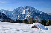 Snow-covered alpine hut with Watzmann in the background, Kleine Reibn, Berchtesgaden Alps, Berchtesgaden National Park, Berchtesgaden, Upper Bavaria, Bavaria, Germany