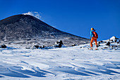 Woman on ski tour climbs to Mount Etna, UNESCO World Heritage Site, Monte Etna, Etna, Etna, Sicily, Italy