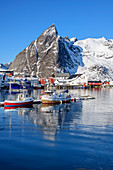 Ships in the port of Hamnoy with snowy mountains, Hamnoy, Lofoten, Nordland, Norway