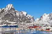 Reine by the sea with snowy mountains, Reine, Lofoten, Nordland, Norway