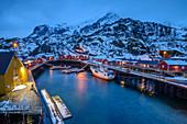 Illuminated Nusfjord harbor with Norwegian red fishermen's houses, Nusfjord, Lofoten, Nordland, Norway