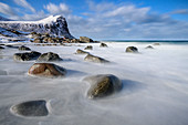 Sea surf rinses over rocks, Lofoten, Nordland, Norway