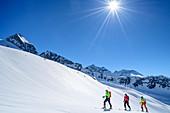 Three people on a ski tour ascend to the Schneekarspitze, Schneekarspitze, Zillertal Alps, Zillertal, Tyrol, Austria