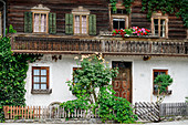 Traditional farmhouse with floral decoration, Stumm, Zillertal, Tyrol, Austria