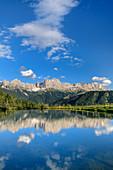 Rosengarten group is reflected in Bergsee, Rosengarten, Dolomites, UNESCO World Heritage Dolomites, South Tyrol, Italy