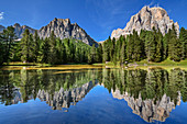 Rock walls of the Tofanen are reflected in mountain lake, Tofana, Dolomites, UNESCO World Heritage Dolomites, Veneto, Italy