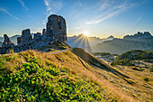 Mountain meadow with sunrise over Cinque Torri, Sorapis and Croda da Lago, Cinque Torri, Dolomites, UNESCO World Heritage Dolomites, Veneto, Italy