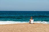 Woman on deserted beach, Roccapina, near Sartène, Corse-du-Sud department, Corsica, France