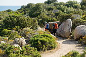 Hikers on the south coast of Corsica, at Sartène, Corse-du-Sud, Corsica, France