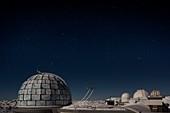 France, Hautes Pyrenees, Bagneres de Bigorre, La Mongie, Pic du Midi de Bigorre (2877m) domes of the observatory under a stary sky