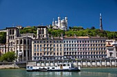 France, Rhone, Lyon, historical site listed as World Heritage by UNESCO, Vieux Lyon district, barge on the Saone, the Cathedral Saint Jean and the basilica Notre-Dame of Fourvière