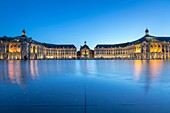 France, Gironde, Bordeaux, area listed as World Heritage by UNESCO, on the Place de la Bourse, the Palais de la Bourse eighteenth century, the fountain of the Three Graces and the tram reflecting in Mirror Water from 2006 and directed by Jean Max Llorca caretaker and architect Pierre Gangnet and planner Michel Corajoud