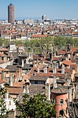 France, Rhone, Lyon, historical site listed as World Heritage by UNESCO, panorama from the Fourviere hill, Maison du Crible also called Tour Rose in the Old Lyon in the foreground and La Part Dieu tower in the background