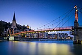 France, Rhone, Lyon, historical site listed as World Heritage by UNESCO, Saint Georges footbridge over the Saone river, Saint Georges church and the Basilica Notre Dame de Fourviere in the background
