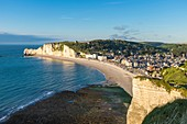 France, Seine Maritime, Pays de Caux, Alabaster Coast, Etretat, the beach and Amont cliff in the background