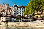 France, Rhone, Lyon, historical site listed as World Heritage by UNESCO, quay and footbridge Saint-Vincent over the river Saône and the district of the Croix Rousse