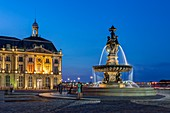 France, Gironde, Bordeaux, area listed as World Heritage by UNESCO, Square of Bourse fountain and the three graces