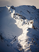 Snow-covered ridges in the morning light, delimited by dark shadows, Stanser Joch, Pertisau, Tyrol, Austria