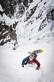 Skier in the arduous ascent through a steep gully, Wilder Kaiser, Tyrol, Austria
