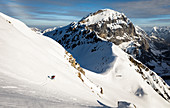 Skier traces her trail through rocky terrain,